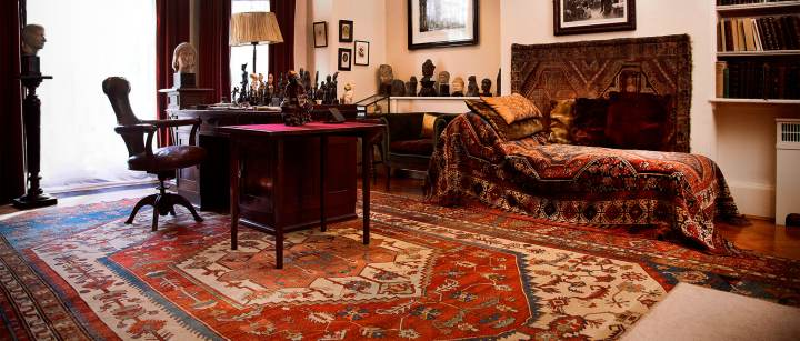 Lessons from Freud: layering rugs is cozy and inviting!